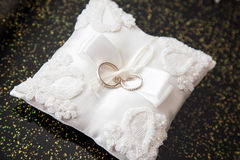 Two Wedding Rings On A Pillow Stock Photos