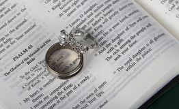 Two wedding rings on an open Holy Bible. Two wedding rings on open Holy Bible Royalty Free Stock Photos