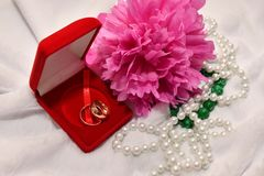 Two wedding rings and Peony flower. Stock Photo