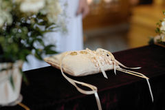 Two wedding rings on the pillow. Two golden wedding rings on the pillow close-up Stock Image