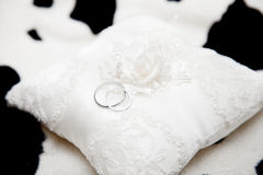 Two wedding rings on a pillow close-up Royalty Free Stock Images