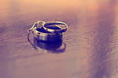 Wedding rings on table Stock Photos