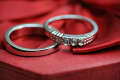 Two wedding rings on a red background Royalty Free Stock Image