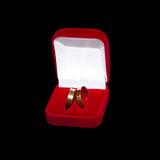 Two wedding rings in red box stock images