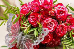 Two wedding rings, red roses. Arsenie butterfly. Stock Images