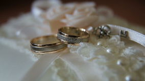 Two wedding rings. Two wedding ring on a beautiful cushion.Wedding concept stock video