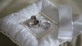 Two wedding rings. Two wedding ring on a beautiful cushion.Wedding concept stock footage