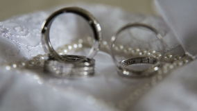 Two wedding rings. Two wedding ring on a beautiful cushion.Wedding concept stock video footage