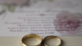 Two wedding rings. Two wedding ring on wedding Invitation. Wedding concept stock video footage
