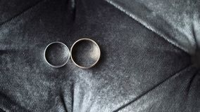 Two wedding rings. On sofa stock video footage