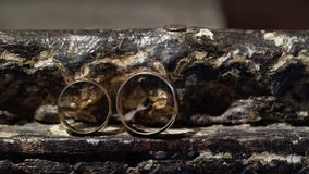 Two wedding rings. On stone table stock video