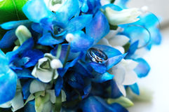Two wedding rings on a wedding bouquet Stock Photography