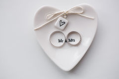 Two wedding rings on a white background.. Mr. and Mrs Stock Image