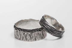Two wedding rings on a white background.. Mr. and Mrs. wood texture Royalty Free Stock Image