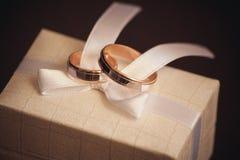 Two wedding rings on white bow Stock Photo