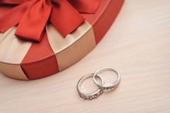 Two wedding rings on a wooden background Royalty Free Stock Photo