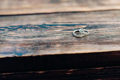Two wedding rings on a wooden background. 1 Stock Photography