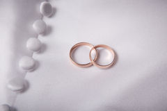 Two weddings rings Stock Photos
