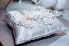 Two weddings rings on a background of fabric Stock Image