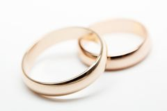 Two  weddings rings on white  fabric Stock Photography