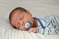 Two weeks old newborn baby boy sleeping with dummy in mouth i love you mama stock photos