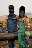 Two welder construction worker friends. Smiling with arms around each other Stock Photo