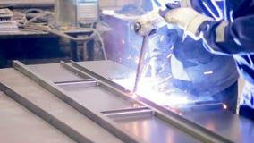 Two welders working. Metalworking plant, welders welding metal. Teamwork at factory stock video