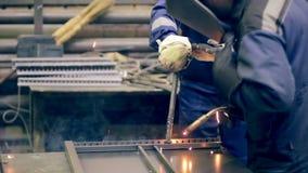 Two welders working. Metalworking plant, welders welding metal. Teamwork at factory stock footage
