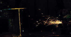 Two welders working in workshop stock video