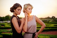 Two well dressed woman in a beautiful park. Stock Photography