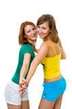 Two wemen friends holding each others hands Stock Photo