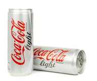Two wet cans of coca cola light. NIEDERSACHSEN, GERMANY APRIL 9, 2017:Two cans of wet coca cola light on a white background Royalty Free Stock Image