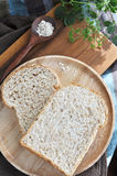 Two wheat bread on wooden plate Royalty Free Stock Image