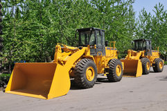 Two wheel loader machine in queue Stock Photo