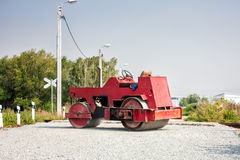 Two wheel tandem roller. Two-wheel tandem roller at railway crossing stock photo