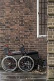 Two wheelchairs outside a hospital Royalty Free Stock Photo