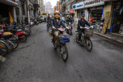 Two-wheeled motorized vehicles on a street in Shanghai, China. Stock Photography