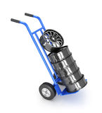 Two-wheeled trolley with car rims Stock Image