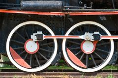 Two wheels view of old fashioned steam locomotive Stock Image