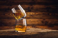 Whiskey glass on the old wooden table Royalty Free Stock Photography