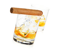 Two whiskey glasses and cigar Stock Image