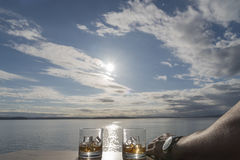 Two Whiskey on rocks to the sun royalty free stock images