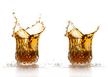 Two Whiskey Splash Isolated on White Background Stock Photography