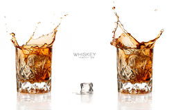 Two Whiskey Splash Isolated on White Background Royalty Free Stock Photo