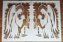 Two white angel. Paper cutting art. Stock Image