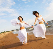 Two white angels on the beach Stock Images