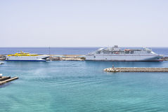 Two white auto ferries lying at a pier. Stock Photos
