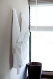 Two white bathrobes Stock Images
