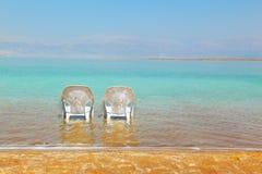 Two white beach chairs Royalty Free Stock Photos
