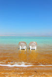 Two white beach chairs Royalty Free Stock Images